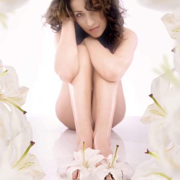 Young woman in white flowers