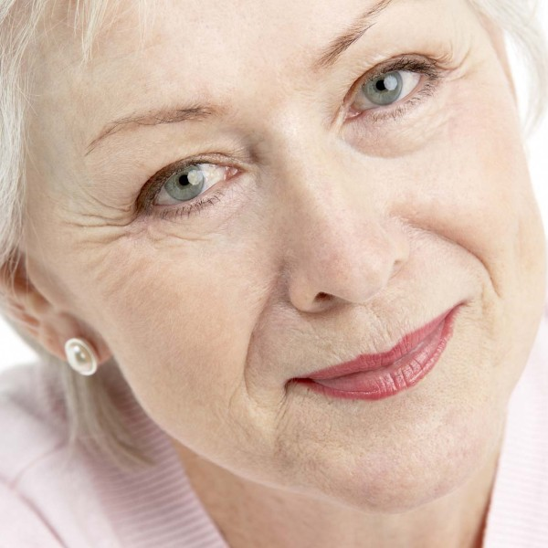 Studio Portrait Of Smiling Senior Woman